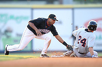Akron Aeros Shortstop Cristo Arnal (28) tags out Nick Evans during a game vs. the Binghamton Mets at Eastwood Field in Akron, Ohio;  June 25, 2010.   Binghamton defeated Akron 5-3.  Photo By Mike Janes/Four Seam Images
