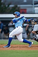Xavier Fernandez (34) of the Burlington Royals follows through on his swing against the Pulaski Yankees at Burlington Athletic Park on August 6, 2015 in Burlington, North Carolina.  The Royals defeated the Yankees 1-0. (Brian Westerholt/Four Seam Images)