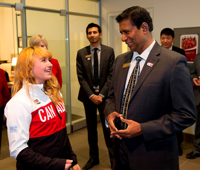 Calgary, Alta.---31/3/2014--- Venki Raman, CIBC district vice president, Calgary North, with Canadian Paralympic Team para-alpine skier Alexandra Starker at the Paralympian Welcome Home event in Calgary. Photo: The Canadian Press Images/Larry MacDougal<br />