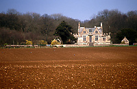 A Jacobean hunting lodge is seenover a freshly ploughed field