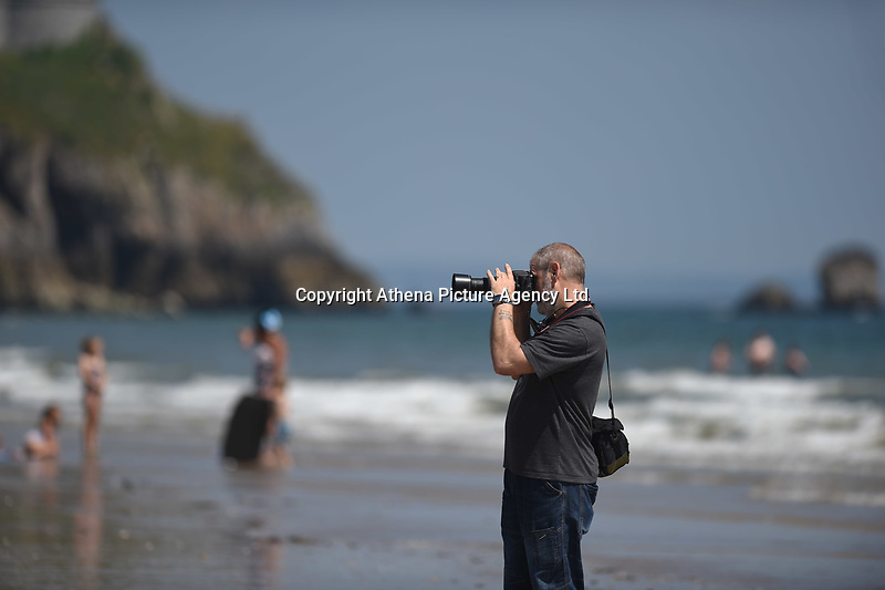 Thursday 25 May 2017<br /> Pictured: A man takes a snap in the warm sunshine <br /> Re: People enjoy the warm sunshine in Tenby, , West Wales. Temperatures today are expected to reach the high 20s Centigrade in many parts of the UK, making it one of  warmest days of the year so far