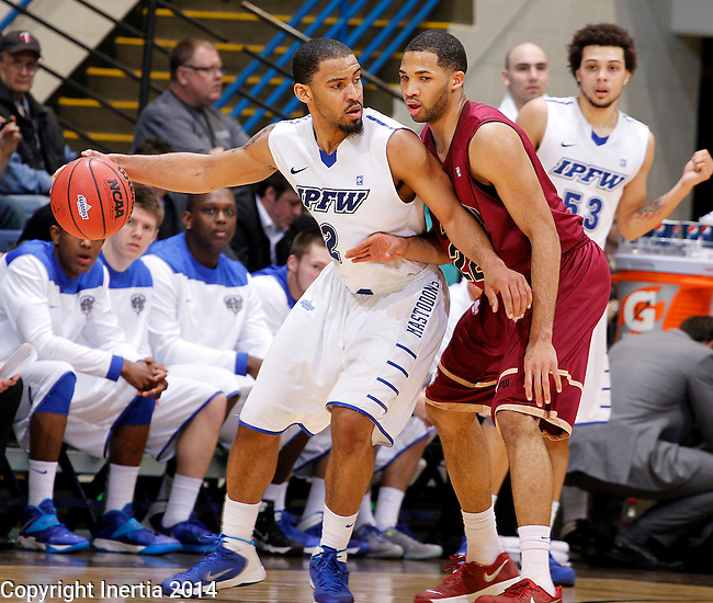SIOUX FALLS, SD - MARCH 8:  Pierre Bland #2 from IPFW backs down Marcellus Barksdale #22 from IUPUI in the second half of their semifinal game Saturday afternoon at the 2014 Summit League Basketball Tournament in Sioux Falls, SD. (Photo by Dave Eggen/Inertia)
