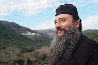 Mount Athos - The Holy Mountain.<br /> A monk looks out over Mount Athos.
