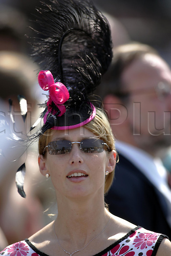 31 July 2004:  Portrait of a young lady wearing a delicate feathered hat at Goodwood Photo: Glyn Kirk/Action Plus...horse racing 040731 fashion sunglasses glorious