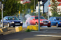 Car burning rubber on a stop light in Akureyri early morning