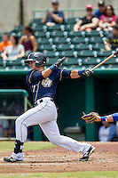 San Antonio Missions outfielder Alberth Martinez (21) follows through on his swing during the Texas League baseball game against the Midland RockHounds on June 28, 2015 at Nelson Wolff Stadium in San Antonio, Texas. The Missions defeated the RockHounds 7-2. (Andrew Woolley/Four Seam Images)