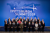Pittsburgh, PA - September 25, 2009 -- Leaders from the Group of 20 nations take part in a group  photo on day two of the G-20 summit in Pittsburgh, Pennsylvania, U.S., on Friday, September 25, 2009. G-20 leaders are working on an accord to prevent a repeat of the worst global financial crisis since the Great Depression and ensure a sustained recovery. G-20 leaders and summit attendees pose for a group photo during the G-20 summit, Friday, September 25, 2009 in Pittsburgh. They are, from left to right from front to back; South African President Kgalema Motlanthe, South Korean President Lee Myung-Bak, French President Nicolas Sarkozy, Indonesian President Susilo Bambang Yudhoyono, Brazilian President Luiz Inacio Lula de Silva, President Barack Obama, Chinese President Hu Jintao, Mexican President Felipe Calderon, Argentine President Cristina Fernandez de Kirchner, Russian President Dmitry Medvedev, Canadian Prime Minister Steven Harper, Saudi Foreign Minister Prince Saud al-Faisal, Japanese Prime Minister Yukio Hatoyama, Australian Prime Minister Kevin Rudd, Sweden Prime Minister John Fredrik Reinfeldt, German Chancellor Angela Merkel, United Kingdom Prime Minister Gordon Brown, Turkish Prime Minister Recep Tayyip Erdogan, Indian Prime Minister Mommohan Singh, Dutch Prime Minister Jan Peter Balkenende, Spanish Prime Minister Jose Luis Rodriguez Zapatero, Italian Prime Minister Silvio Berlusconi, EU President Jose Manuel Barroso, Singapore Finance Minister Tharman Shanmugaratnam, Thai Prime Minister Abhisit Bejjajiba represent ASEAN, Managing director of the International Monetary Fund, Dominique Strauss-Kahn, Director General of the ILO Juan Somavia, UN Secretary-General Ban Ki-moon, World Bank President Robert Zoellick, Secretary General of the OECD Angel Gurria, World Trade Organization Director General Pascal Lamy, Governor of the Banca d'Italia Mario Draghi representing the Financial Stability Board. .Credit: Andrew Harrer / Pool via CNP