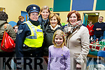 Sgt Eileen O'Sullivan, Heide and Evie Giles, with Grace and Irene O'Donnell at the St Johns Church of Ireland Christmas fair in Teach an tSolais on Saturday