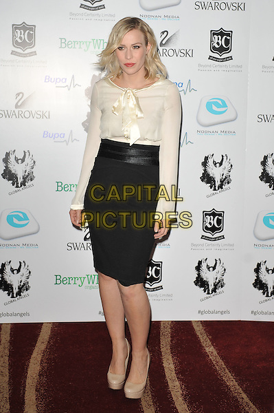Natasha Bedingfield.'Global Angels Awards', The Park Plaza Hotel, Westminster, London, England. 2nd December 2011..full length white cream top bow long sleeve black skirt nude beige shoes .CAP/MAR.© Martin Harris/Capital Pictures.