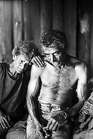 Poor couple, blind elderly woman. Contemporary slavery at charcoal production. City: Ribas do Rio Pardo, State: Mato Grosso do Sul, Brazil.