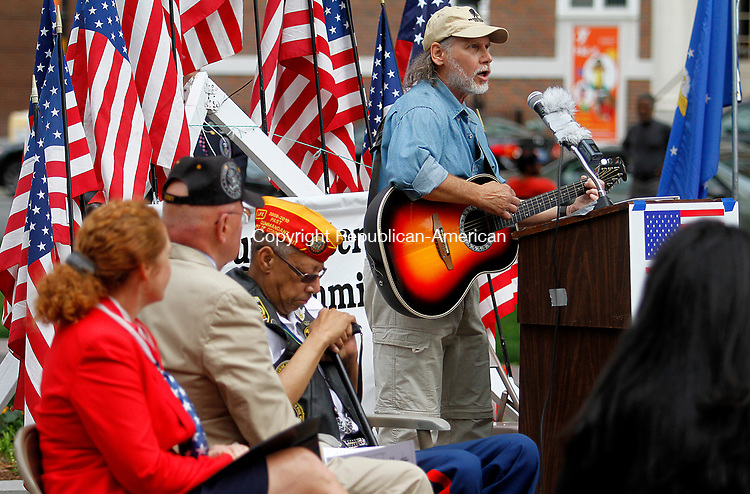 "WATERBURY, CT - 29 JULY 2017 - 072917JW01.jpg -- Ric Speck sings his song ""The Forgotten Ones"" honoring the U.S. soldiers who fought in the Korean War during the Korean War Remembrance Day Ceremony Saturday morning on the Waterbury Green.  Jonathan Wilcox Republican-American"