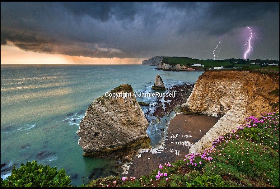 BNPS.co.uk (01202 55883&pound;)<br /> Pic: JamieRussell/BNPS<br /> <br /> ***Please Use Full Byline***<br /> <br /> Freshwater Bay, thunderstorm.<br /> <br /> Stunning photographs have revealed a turbulent side to the normally genteel Isle of Wight.<br /> <br /> The seemingly benign south coast holiday destination has been catalogued over a stormy year by local photographer Jamie Russell, and his astonishing pictures reveal the dramatic changes in weather that roll across the UK in just 12 months.<br /> <br /> Lightning storms, ice, floods, gales and blizzards have all been captured by the intrepid photographer who frequently got up in the middle of the night to capture the climatic chaos.<br /> <br /> Looking at these pictures prospective holidaymakers could be forgiven for thinking twice about a gentle staycation on the south coast island.