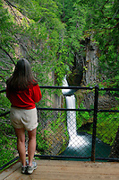 A visitor (MR) views the Toketee Falls in the Umpqua National Forest, Orego