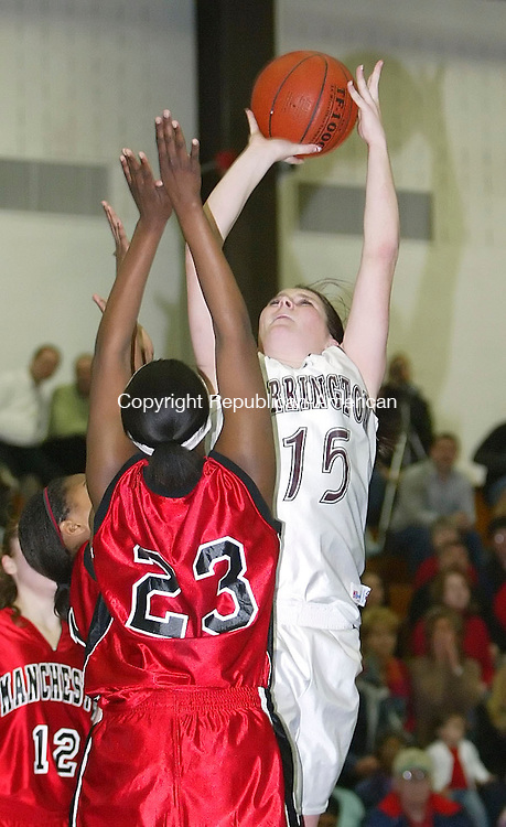 GLASTONBURY, CT, 03/06/07- 030607BZ10- Torrington's Erika Murphy (15) goes to the hoop against Manchester's Shanika Hines (23) during the Class LL semifinals at Glastonbury High School Tuesday. <br /> Jamison C. Bazinet Republican-American