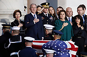 Former President George W. Bush and other family members watch as the flag-draped of former President George H.W. Bush is carried by a joint services military honor guard to lie in state in the rotunda of the U.S. Capitol, Monday, Dec. 3, 2018, in Washington. (AP Photo/Alex Brandon, Pool)