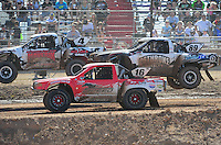 Apr 16, 2011; Surprise, AZ USA; LOORRS driver Dawson Kirchner (16) battles for position with Jason Ellis (89) and Ron Duncombe (4) during round 3 at Speedworld Off Road Park. Mandatory Credit: Mark J. Rebilas-.