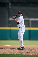 Detroit Tigers pitcher Angel Reyes (25) gets ready to deliver a pitch during a Florida Instructional League game against the Pittsburgh Pirates on October 6, 2018 at Joker Marchant Stadium in Lakeland, Florida.  (Mike Janes/Four Seam Images)
