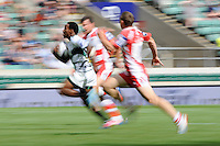 Carlin Isles of San Francisco Golden Gate leaves Steph Reynolds (near) and Gareth Evans of Gloucester Rugby 7s standing as he accelerates away to score a try during the World Club 7s at Twickenham on Sunday 18th August 2013 (Photo by Rob Munro)