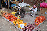 Young boys selling fruit and vegetables in the Sharia Souk in Luxor.The town of Luxor occupies the Eastern part of a great city of antiquity which the ancient Egytians called Waset and the Greeks named Thebes.