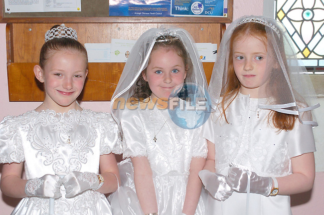 Rebecca Carolan, Aoife carry and Timika cassidy making there First communion in Tullyallen Church.Photo Fran Caffrey Newsfile.ie..This Picture has been sent to you by Newsfile Ltd..The Studio,.Millmount Abbey,.Drogheda,.Co. Meath,.Ireland..Tel: +353(0)41-9871240.Fax: +353(0)41-9871260.ISDN: +353(0)41-9871010.www.newsfile.ie..general email: pictures@newsfile.ie