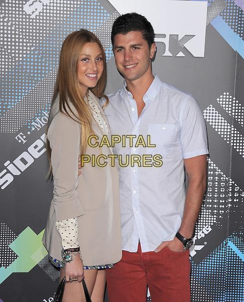 WHITNEY PORT & BEN NEMTIN .at The T-Mobile Sidekick 4G Launch Party held at a private lot in Beverly Hills, California, USA, April 20th 2011..half length grey gray jacket blazer couple blue shirt red jeans  .CAP/RKE/DVS.©DVS/RockinExposures/Capital Pictures.