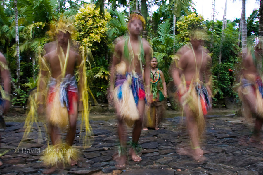 A blurred image of native dancers performing on the island of Yap, Micronesia.