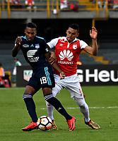 BOGOTA - COLOMBIA - 01 - 03 - 2018: Yeison Gordillo (Der.) jugador de Independiente Santa Fe disputa el balón con Eduard Preciado (Izq.) jugador de Emelec (ECU), durante partido entre Independiente Santa Fe (COL) y Emelec (ECU), de la fase de grupos, grupo 4, fecha 1 de la Copa Conmebol Libertadores 2018, jugado en el estadio Nemesio Camacho El Campin de la ciudad de Bogota. / Yeison Gordillo (R) player of Independiente Santa Fe vies for the ball with Eduard Preciado (L) player of Emelec (ECU), during a match between Independiente Santa Fe (COL) and Emelec (ECU), of the group stage, group 4, 1st date for the Conmebol Copa Libertadores 2018 at the Nemesio Camacho El Campin Stadium in Bogota city. Photo: VizzorImage  / Luis Ramirez / Staff.