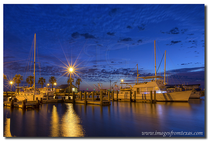 Well before sunrise in Rockport, Texas, this image of boats in a small harbor captures the predawn light and clouds. The wind nearly always blows on the Texas coast, but in this cove, the waters are relatively calm. Texas images such as this are always fun for me to find, and photos from Rockport are pretty easy given the right light and conditions.