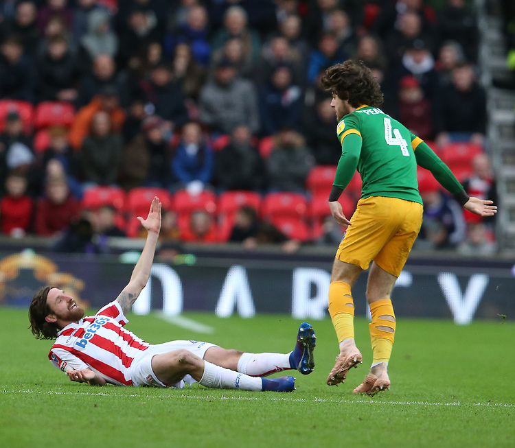 Stoke City's Joe Allen reacts to being tackled by Preston North End's Ben Pearson<br /> <br /> Photographer Stephen White/CameraSport<br /> <br /> The EFL Sky Bet Championship - Stoke City v Preston North End - Saturday 26th January 2019 - bet365 Stadium - Stoke-on-Trent<br /> <br /> World Copyright © 2019 CameraSport. All rights reserved. 43 Linden Ave. Countesthorpe. Leicester. England. LE8 5PG - Tel: +44 (0) 116 277 4147 - admin@camerasport.com - www.camerasport.com
