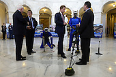 Prince Harry (2-R) of Wales is shown a ground penetrating radar, a tool used for detecting land mines, during a tour of a HALO Trust photo exhibit on landmines and unexploded ordinances, with  HALO Trust Weapons and Ammunition Disposal Desk Officer Richard Boulter (R), Republican Senator from Arizona John McCain (L) and HALO Trust Afghanistan Desk Officer Tim Porter (2-L), on Capitol Hill in Washington DC, USA, 09 May 2013. Prince Harry begins a six-day tour of the United States..Credit: Michael Reynolds / Pool via CNP