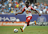 Llyod Sam #10 of New York Red Bulls moves the ball downfield during the second half of a Major League Soccer match against the NYC Football Club at Yankee Stadium on Sunday, July 3, 2016. NYCFC won by a score of 2-0.