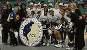 The Blue Devils pose for a photo after clinching the ACC's automatic bid to the 2011 NCAA Women's Basketball Tournament. (Photo by Rob Rowe)