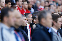 Ryan Giggs, manager for Wales (C) sings the national anthem during the UEFA EURO 2020 Qualifier match between Wales and Slovakia at the Cardiff City Stadium, Cardiff, Wales, UK. Sunday 24 March 2019