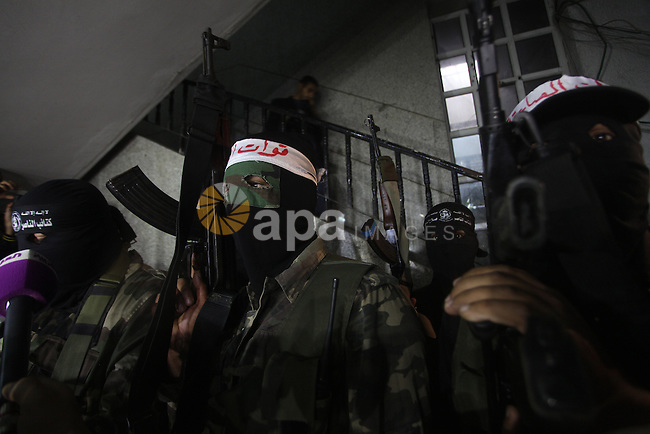 Palestinian masked gunmen, belonging to the Popular Resistance Committees (PRC), attend a press conference in Gaza City on November 11, 2012. The outbreak of violence was one of the most serious since Israel's devastating 22-day operation in the Gaza Strip over New Year 2009, and raised the spectre of a broad Israeli operation against the Palestinian territory. Photo by Ashraf Amra