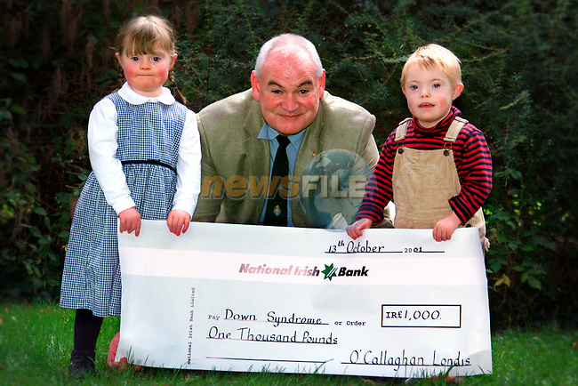 Megan McCormick, Beabeg Drogheda, Michael McCormick, treasurer Down Syndrome Association Louth?Meath branch and Ronan O'Callaghan, Avenue Road Dundalk a cheque for £1,000 from O'Callaghan Londis which was raised from the Ladies Mini Marathon Drogheda and Dundalk..Picture: Paul Mohan/Newsfile