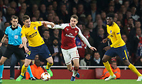 Aaron Ramsey of Arsenal holds off Gabi of Atletico Madrid during the UEFA Europa League Semi Final 1st leg match between Arsenal and Atletico Madrid at the Emirates Stadium, London, England on 26 April 2018. Photo by Andy Aleksiejczuk / PRiME Media Images