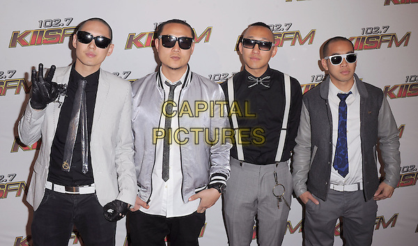 FAR EAST MOVEMENT .Pressroom at the KIIS FM Wango Tango 2011 held at The Staples Center in Los Angeles, California, USA. .May 14th, 2011.half length grey gray top black leather jacket jeans denim Kev Nish Prohgress.J-Splif DJ Virman gloves sunglasses shades hand gesture .CAP/RKE/DVS.©DVS/RockinExposures/Capital Pictures.