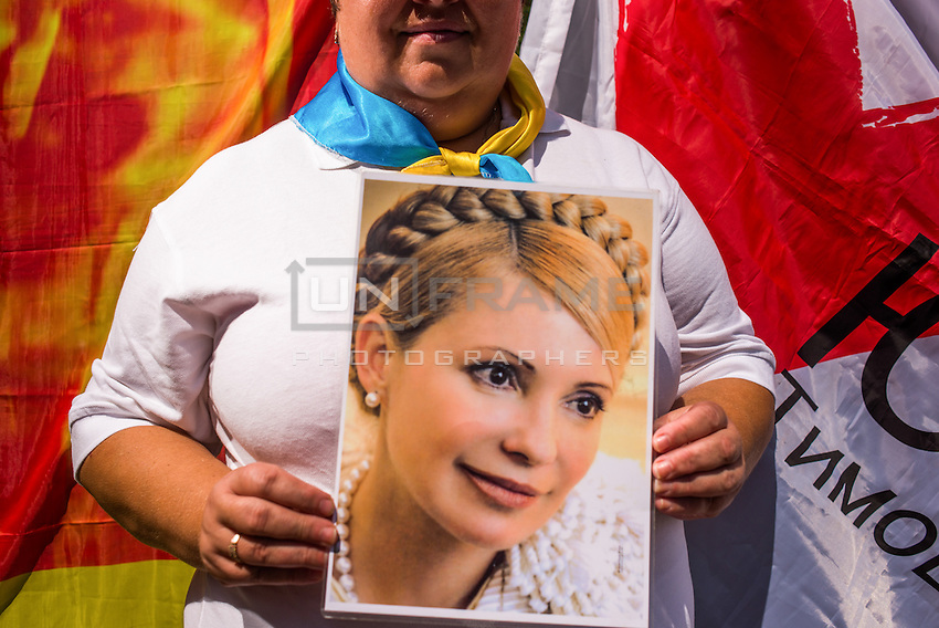 Supporter of former prime minister Yulia Timoshenko demands her release. Thousands of people are continuing to express their support to European integration and protesting against decision of Ukrainian government to refuse signing of association with EU in Vilnius.