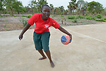 A student dribbles the basketball at the Loreto Girls Secondary School in Rumbek, South Sudan. The school is run by the Institute for the Blessed Virgin Mary--the Loreto Sisters--of Ireland.
