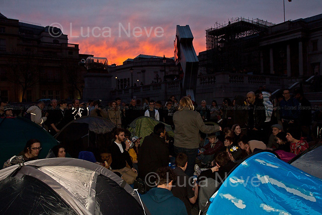 Protesters gathering with tents to create a peaceful occupation.<br /> <br /> London, 02/04/2012. Trafalgar Square is the location of several events and demonstrations today. First, the &quot;World Pillow Fight Day&quot; is a synchronised event being staged in 150 squares across the globe. The second event shows protesters gathering with tents to create a peaceful occupation of the square for 24 hours in protest against the arrests that took place during the rallies of the 26th of March. Thirdly, attention moved towards a large number of people gathering quickly in the square and amassing under Nelson's Column. They were Indian people chanting happily because the Indian Cricket National Team won the 2011 World Cup. Lastly, a group of Skaters arrived and gave a show-stopping performance in front of the National Gallery stairs.