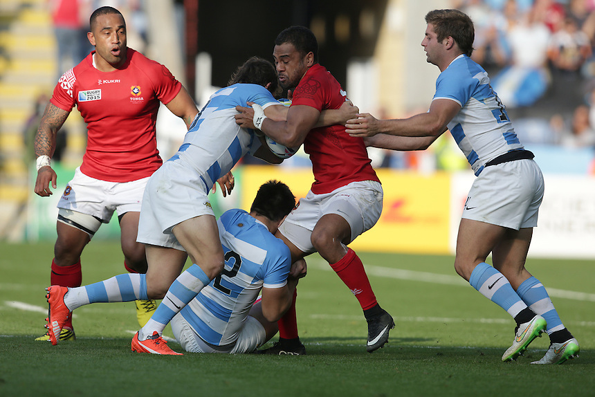 Tonga's Telusa Veainu is tackled by Argentina's Santiago Cordero (right), Nicolas Sanchez (left) and Santiago Gonzalez Iglesias<br /> <br /> Photographer Stephen White/CameraSport<br /> <br /> Rugby Union - 2015 Rugby World Cup Pool C - Argentina v Tonga - Sunday 4th October 2015 - King Power Stadium - Leicester <br /> <br /> &copy; CameraSport - 43 Linden Ave. Countesthorpe. Leicester. England. LE8 5PG - Tel: +44 (0) 116 277 4147 - admin@camerasport.com - www.camerasport.com