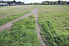 Footpath cutting through a site awaiting development on the edge of an industrial area of Nottingham,