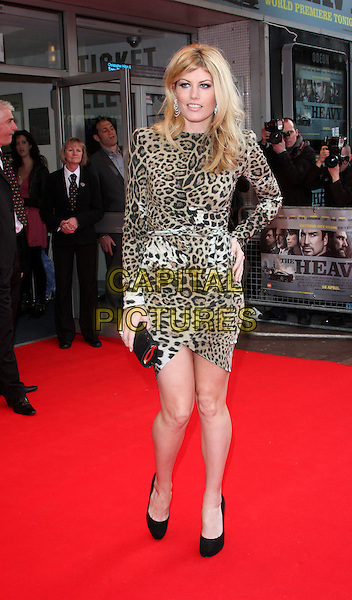MEREDITH OSTROM.World Premiere of 'The Heavy' at the Odeon West End, Leicester Square, London, England, UK, April 15th 2010.arrivals full length brown leopard print animal dress black shoes hand on hip clutch bag waist belt long sleeved sleeves .CAP/ROS.©Steve Ross/Capital Pictures.