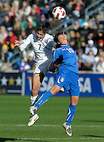 US midfielder Shannon Boxx (7) battles for a header with Italian midfielder Pamela Conti (10).  The U.S. Women's National Team defeated Italy 1-0 at Toyota Park in Bridgeview, IL on November 27, 2010 to advance to the Women's World Cup in Germany.