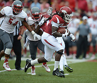 STAFF PHOTO ANTHONY REYES &bull; @NWATONYR<br /> Alex Collins, Razorbacks running backs, breaks through the line of scrimmage against Nicholls State in the first quarter Saturday, Sept. 6, 2014 at Razorback Stadium in Fayetteville.