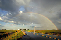 180 degree rainbow over a strip of road in Saline County, Kansas, highway road, rainbows, natural phenomena. Kansas, Saline County.