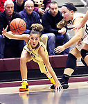NAUGATUCK CT. 11 December 2018-121018SV15-#0 Aamya Rivera of Sacred Heart tries to control the ball as #24 Hailey Deltelbaum of Naugatuck defends during 1st quarter NVL basketball action in Naugatuck Tuesday.<br /> Steven Valenti Republican-American