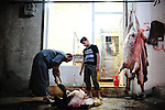 MARI: August 3rd 2012:..A butcher at work in Mari, a liberated town in Aleppo province..Ayman Oghanna for The Sunday Telegraph.