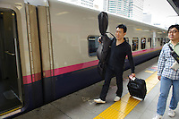 Tokyo station, Tokyo, Japan, May 1, 2011.The Tokyo Sinfonia travelled to Miyagi Prefecture in north east Japan to performing for victims of the March 11 2011 earthquake and Tsunami.