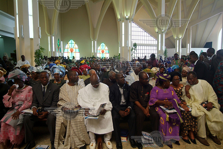 Top Nigerian government officials attend a function at the Abuja Christian Centre.